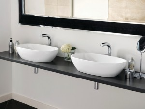 two white bathroom sinks